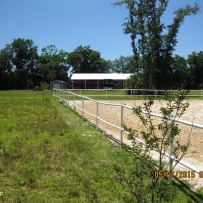 Pasture and Arena with Boarding Barn in the Backgroung
